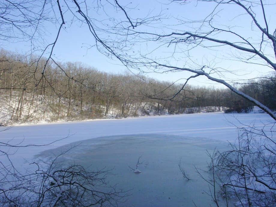 Photo by Rob McWilliams Godfrey Pond after a winter storm in Devil's Den.
