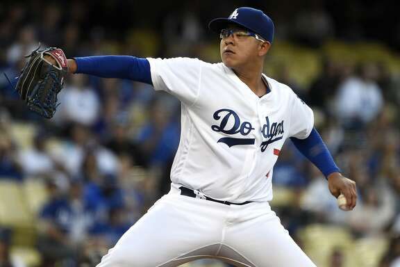 Los Angeles Dodgers starting pitcher Julio Urias pitches during the first inning of a baseball game against the Colorado Rockies in Los Angeles, Tuesday, June 7, 2016. (AP Photo/Kelvin Kuo)