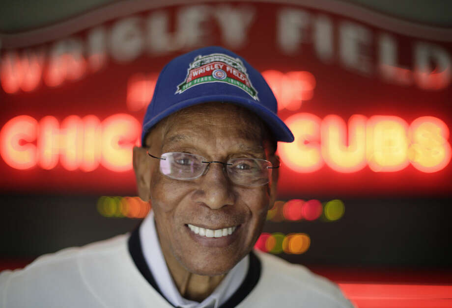 FILE - In this March 24, 2014, file photo Chicago Cubs Hall of Fame slugger Ernie Banks smiles after an interview at the Cubs offices in Chicago. The Cubs announced Friday night, Jan. 23, 2015, that Banks had died. He was 83. (AP Photo/M. Spencer Green, File)