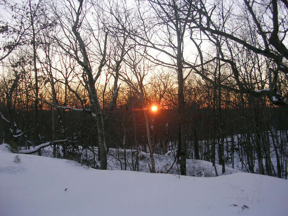 Photo by Rob McWilliams Sunset on the Hiltebeitel Trail in Devil's Den in winter.