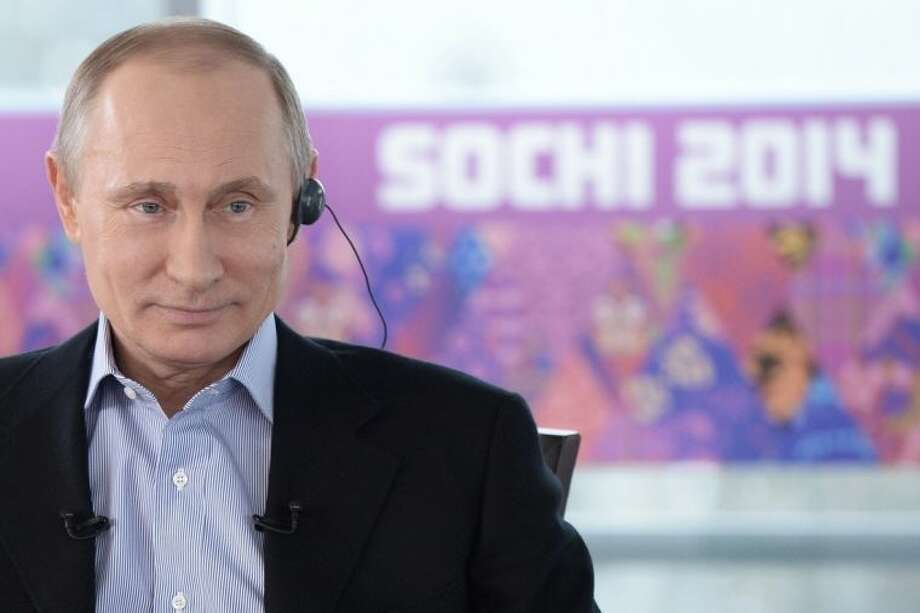 "In this Friday, Jan. 17, 2014 photo made available by Presidential Press Service on Sunday, Jan. 19, 2014, Russian President Vladimir Putin listens to a translation during an interview to Russian and foreign media at the Russian Black Sea resort of Sochi, which will host Winter Olympic Games on Feb. 7, 2014. President Vladimir Putin once again has offered assurances to gays planning to attend the Sochi Olympics, but his arguments defending Russia's ban on homosexual ""propaganda"" to minors show the vast gulf between how he understands the issues and how homosexuality is generally viewed in the West. In an interview with Russian and foreign television stations broadcast Sunday, Putin equated gays with pedophiles and spoke of the need for Russia to ""cleanse"" itself of homosexuality as part of efforts to increase the birth rate. (AP Photo/RIA Novosti, Alexei Nikolsky, Presidential Press Service)"