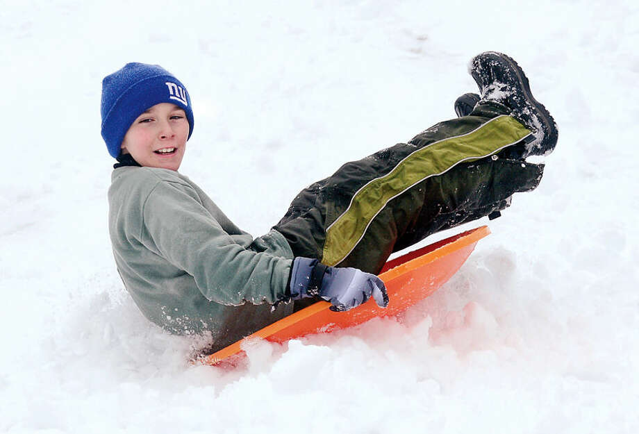 Hour photo / Erik Trautmann Kevin Artale, 10 sleds at Wolfpit School following the snowfall early Saturday morning.