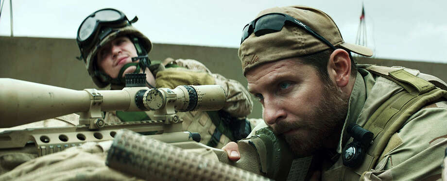 "In this image released by Warner Bros. Pictures, Kyle Gallner, left, and Bradley Cooper appear in a scene from ""American Sniper."" The film is based on the autobiography by Chris Kyle. (AP Photo/Warner Bros. Pictures)"