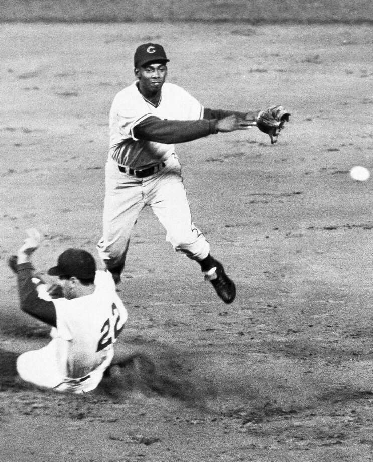 REMOVES REFERENCE OF ST. LOUIS CARINDALS PLAYER GINO CIMOLI, AND CORRECTS DATE TO AN UNDATED 1970 FILE PHOTO - FILE - In this undated 1970, file photo, Chicago Cubs' Ernie Banks, top, turns a double play in a baseball game. The Cubs announced Friday night, Jan. 23, 2015, that Banks had died. The team did not provide any further details. Banks was 83. (AP Photo/File)