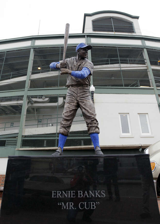 FILE - In this Nov. 11, 2011, file photo, a 400-pound bronze statue of Chicago Cubs great Ernie Banks is placed outside Wrigley Field in Chicago after it went through restoration at Bradley University in Peoria, Ill. The Cubs announced Friday night, Jan. 23, 2015, that Banks had died. The team did not provide any further details. Banks was 83. (AP Photo/Nam Y. Huh, File)