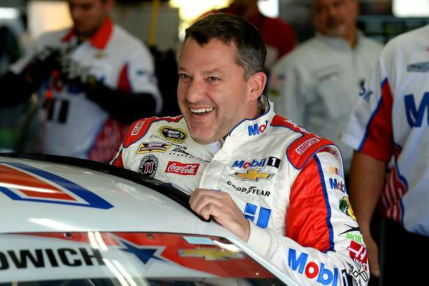 NASCAR Sprint Cup Series driver Tony Stewart laughs with members of his team as he climbs into his car for practice at Charlotte Motor Speedway in Concord, N.C., on Thursday, May 26, 2016. (Jeff Siner/Charlotte Observer/TNS)