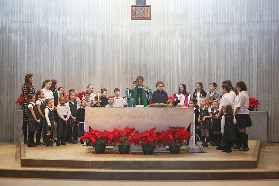 All Saints students participate in Mass with Father Sudhir to kick off National Catholic Schools Week at St. Philips Parish in Norwalk Sunday morning. Hour Photo / Danielle Calloway