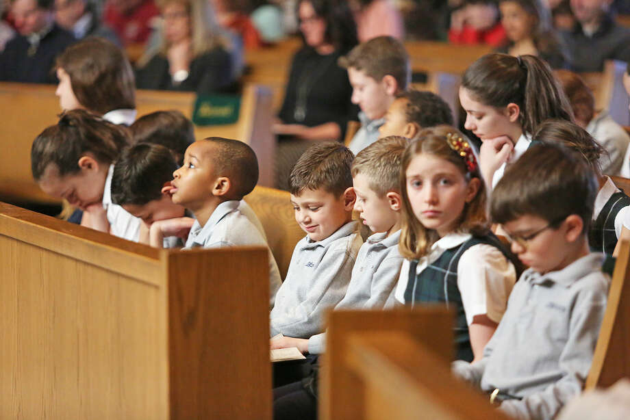 All Saints students participate in Mass to kick off National Catholic Schools Week at St. Philips Parish in Norwalk Sunday morning. Hour Photo / Danielle Calloway