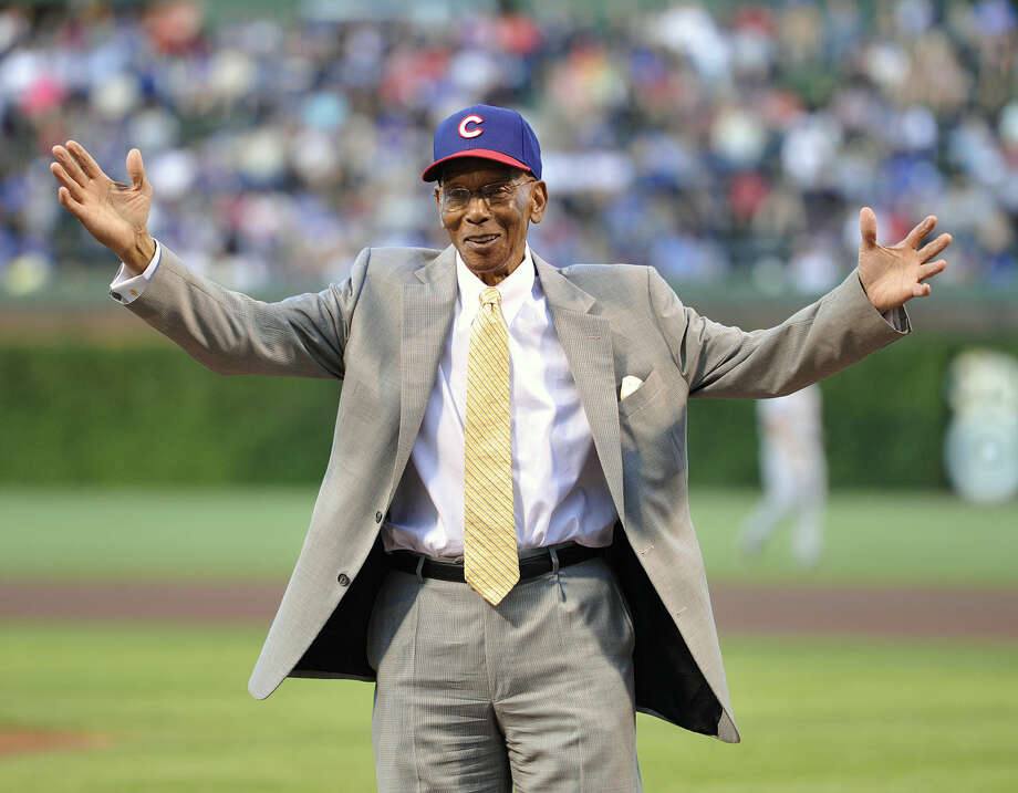 FILE - Int his Aug. 13, 2013, file photl, former Chicago Cubs infielder Ernie Banks waves to the crowd before the Cubs' baseball game against the Cincinnati Reds in Chicago. Banks, the two-time MVP who never lost his boundless enthusiasm for baseball despite years of playing on losing Cubs teams, died Friday night, Jan. 23, 2015. He was 83. The Cubs announced Banks' death, but did not provide a cause. (AP Photo/Jim Prisching, File)
