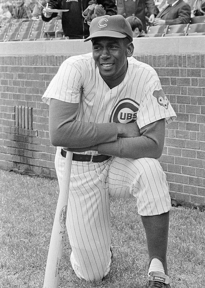 FILE - In this May 11, 1970, file photo, Chicago Cubs first baseman Ernie Banks looks toward the outfield fences of Wrigley Field in Chicago. The Cubs announced Friday night, Jan. 23, 2015, that Banks had died. The team did not provide any further details. Banks was 83. (AP Photo/Leg, File)