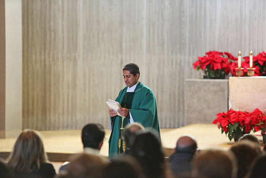Father Sudhir leads a Mass to kick off National Catholic Schools Week at St. Philips Parish in Norwalk Sunday morning. Hour Photo / Danielle Calloway