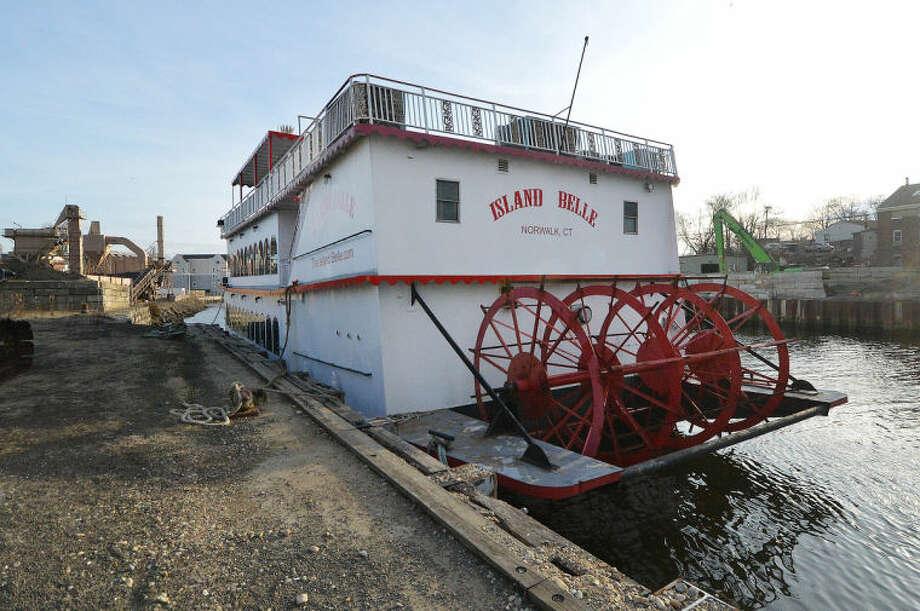 Hour Photo/Alex von Kleydorff The Island Belle tied up along the Norwalk River on Monday