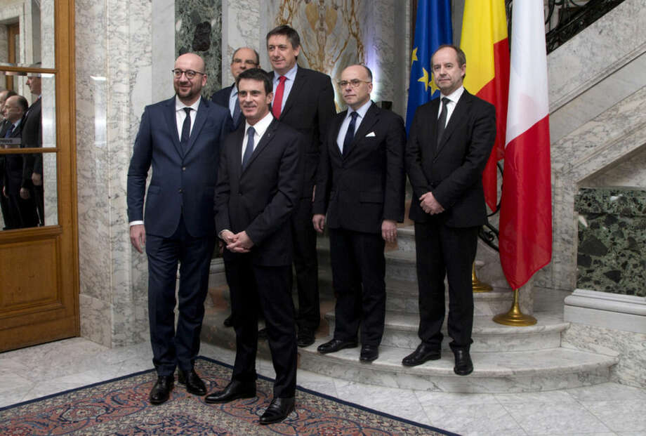 Belgian Prime Minister Charles Michel, left, stands with from left, Belgian Minister of Justice Koen Geens, French Prime Minister Manuel Valls, Belgian Interior Minister Jan Jambon, French Interior Minister Bernard Cazeneuve, and French Minister of Justice Jean-Jacques Urvoas prior to a meeting to coordinate a response to violent extremism at Chateau Val Duchesse in Brussels on Monday, Feb. 1, 2016. (AP Photo/Virginia Mayo)