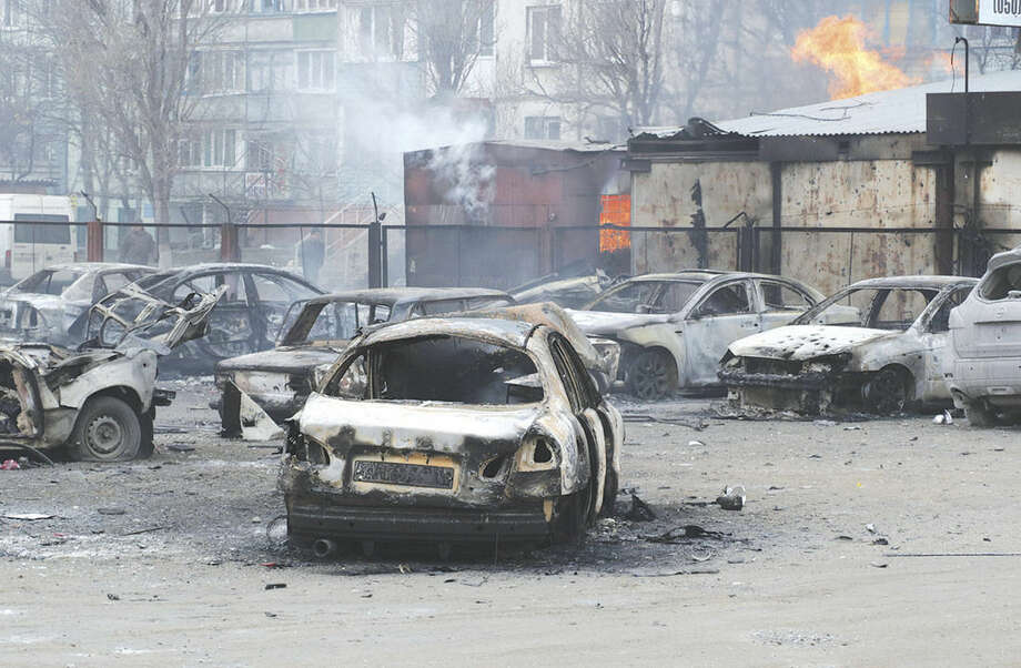 AP photo/Sergey VaganovBurned cars on a destroyed parking site in a residential area in Mariupol, Ukraine, Saturday. A crowded open-air market in Ukraine's strategically important coastal city of Mariupol came under rocket fire Saturday morning, killing at least 30 people, regional police said.