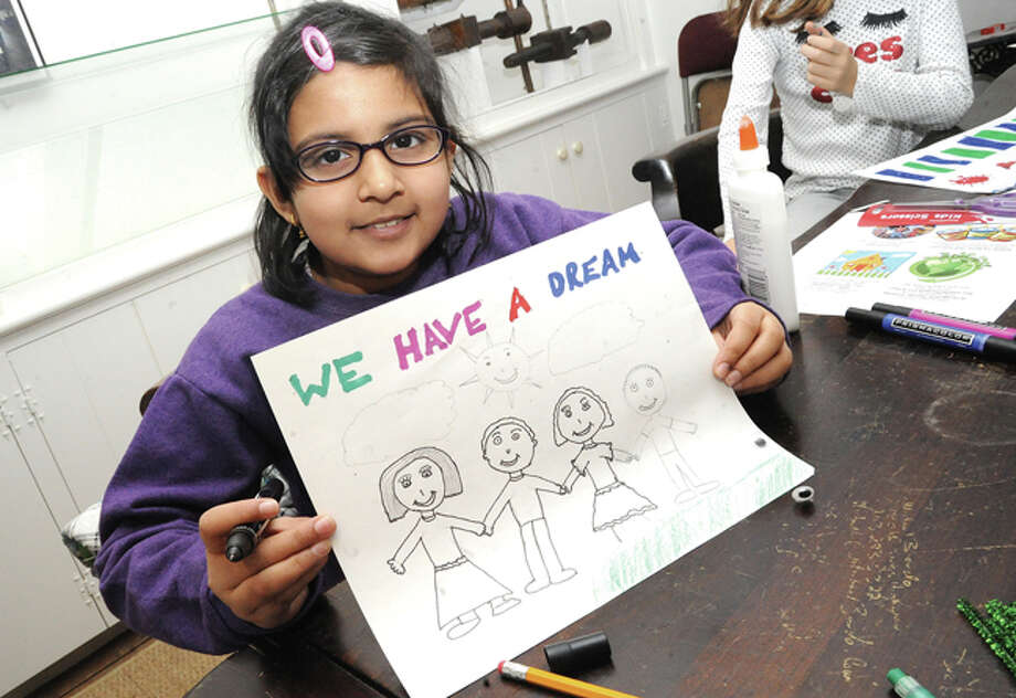 Tanvi Rajan, 8, with a work-in-progress Monday at the Wilton Historical Society, where kids entered the Martin Luther King, Jr. poster contest.