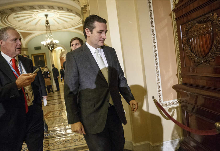 FILE - In this Dec. 16, 2014 file photo, Sen. Ted Cruz, R-Texas arrives at the Senate on Capitol Hill in Washington. Florida Sen. Marco Rubio seems to be moving toward a bid for the Republicans' presidential nomination, and late Sunday he joins Sens. Ted Cruz of Texas and Rand Paul of Kentucky for an audience with the conservative billionaire Koch brothers. (AP Photo/J. Scott Applewhite, File)
