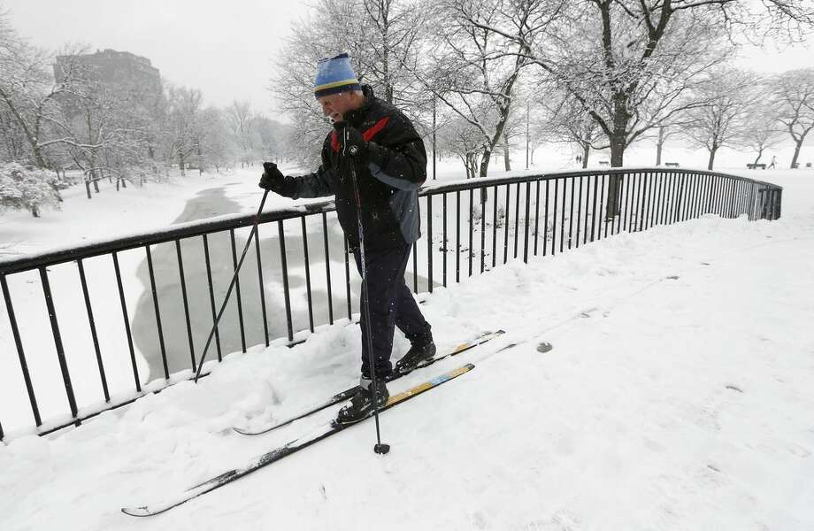 Irv Rosenberg, of Boston, uses cross country skis on the Esplanade in Boston, Saturday, Jan. 24, 2015. A winter storm warning covering Boston and Hartford, Connecticut was in effect through 7 p.m. as the National Weather Service said to expect 4 to 8 inches of wet snow to fall by the time the storm moves out. (AP Photo/Michael Dwyer)