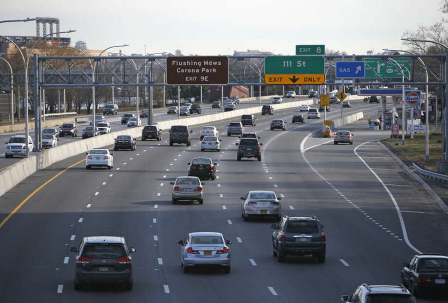 Cars travel eastbound on the Grand Central Parkway opposite LaGuardia Airport in New York, Wednesday, Jan. 21, 2015. New York Gov. Andrew Cuomo has proposed an elevated AirTrain to the airport, one of the nation's busiest. Cuomo's plan calls for a rail link connecting LaGuardia with the Willets Point station 1.5 miles away. The station, opposite the New York Mets' ballpark, upper left, serves both the Long Island Rail Road commuter rail and the No. 7 subway line. (AP Photo/Kathy Willens)