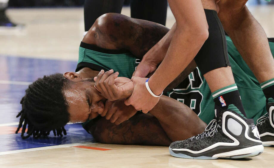 Boston Celtics forward Jae Crowder (99) grimaces after taking an elbow to his face from New York Knicks forward Carmelo Anthony during the first quarter of an NBA basketball game, Tuesday, Feb. 2, 2016, in New York. Anthony was called with a flagrant foul on the play. (AP Photo/Julie Jacobson)