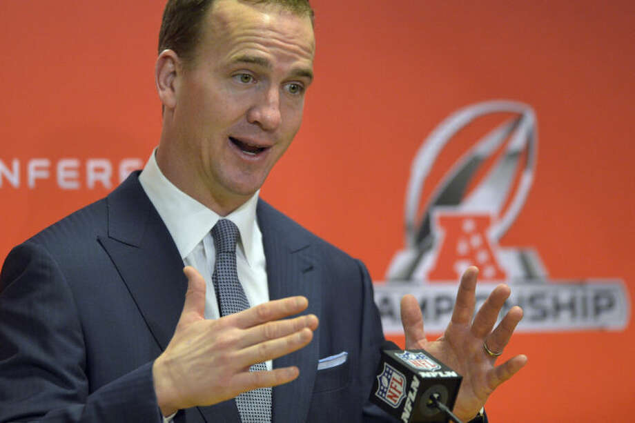 Denver Broncos quarterback Peyton Manning answers questions at the post game press conference after the AFC Championship NFL playoff football game in Denver, Sunday, Jan. 19, 2014. The Broncos defeated the Patriots 26-16 to advance to the Super Bowl. (AP Photo/Jack Dempsey)