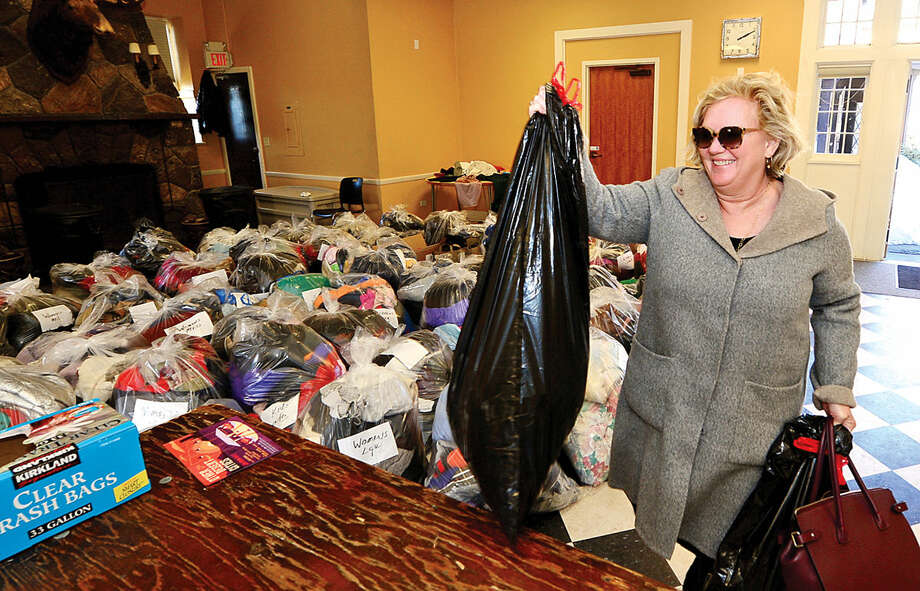 "Hour photo / Erik Trautmann Norwalk resident Margaret Iskyan drops of outerwear during The Rowayton Community Association's first annual winter ""Bundle Up Rowayton"" clothing drive Saturday at the Rowayton Community Center to benefit the Open Door Shelter in South Norwalk."
