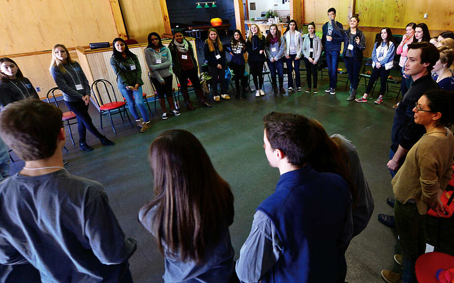 Hour photo / Erik Trautmann Members of The Wilton Youth Council, Wilton C.O.D.E.S., the Teen Awareness Group of Staples High School and Weston Youth Services engage in team building excercises during the 3W Youth Leadership Conference at Trackside Teen Center Saturday.