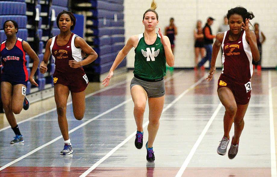 Hour photo / Erik Trautmann Norwalk High School's Deanna Singewald competes in the 50M dash in the FCIACEastern Division championship track meet at Wilton High School Saturday.