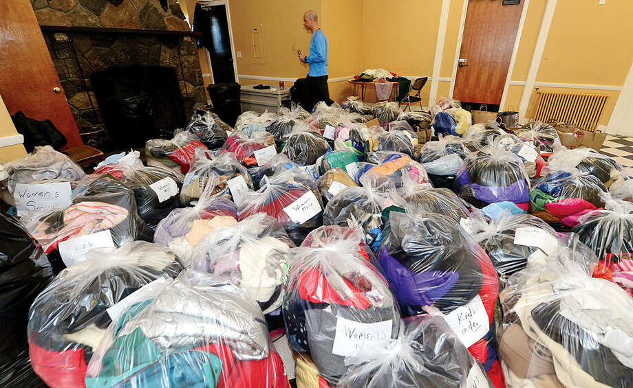 """Hour photo / Erik Trautmann Over 100 bags of outerwear was donated to The Rowayton Community Association's first annual winter """"Bundle Up Rowayton"""" clothing drive Saturday at the Rowayton Community Center to help benefit the Open Door Shelter in South Norwalk."""