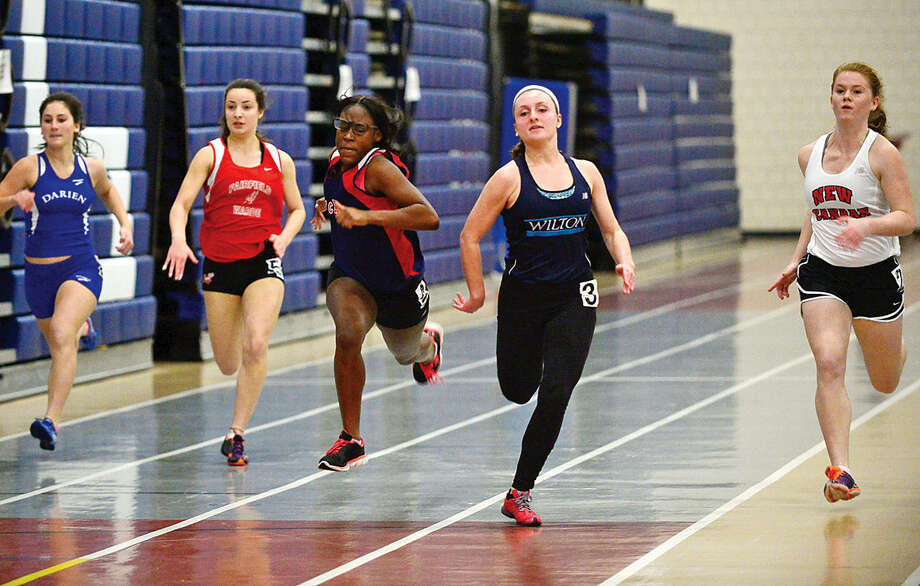 Area high School athletes compete in the FCIACEastern Division championship track meet at Wilton High School Saturday.