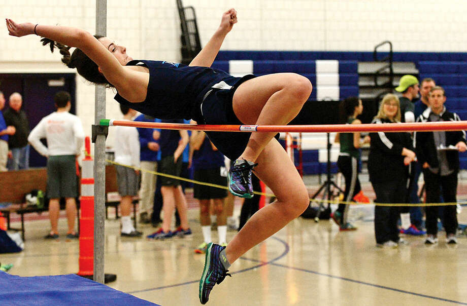 Hour photo / Erik Trautmann Wilton High School's Claire Graham competes in the high jump during the FCIAC Eastern Division championship track meet at Wilton High School Saturday.