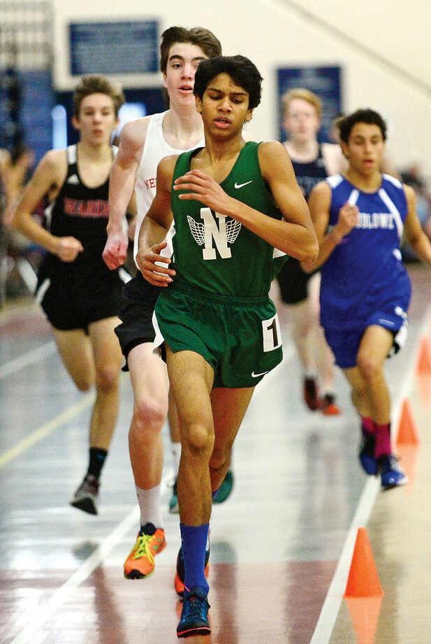 Hour photo / Erik Trautmann Norwalk High School's Dishva Patel competes in the FCIACEastern Division championship track meet at Wilton High School Saturday.
