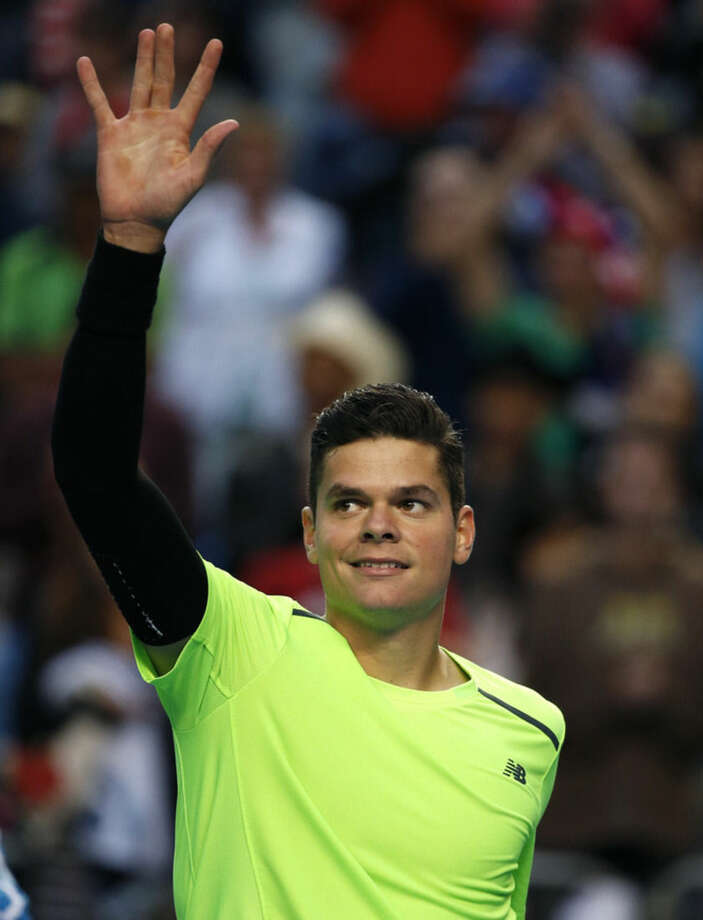 Milos Raonic of Canada celebrates after defeating Feliciano Lopez of Spain in their fourth round match at the Australian Open tennis championship in Melbourne, Australia, Monday, Jan. 26, 2015. (AP Photo/Vincent Thian)