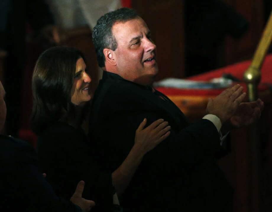 New Jersey Gov. Chris Christie and his wife Mary Pat applaud during a hymn as they attend a prayer service in celebration of his inauguration at the New Hope Baptist Church on Tuesday, Jan. 21, 2014 in Newark. The celebrations to mark the start of Christie's second term could be tempered by investigations into traffic tie-ups that appear to have been ordered by his staff for political retribution and an allegation that his administration linked Superstorm Sandy aid to approval for a real estate project. (AP Photo/Rich Schultz)