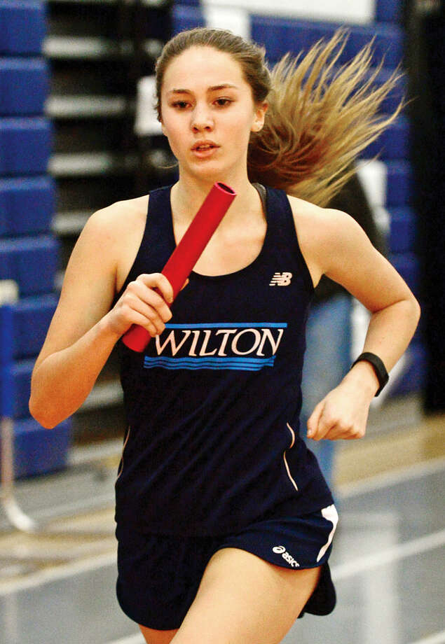 Hour photo / Erik Trautmann Wilton High School's Emma Westholm competes in the SMR during the FCIAC Eastern Division championship track meet at Wilton High School Saturday.