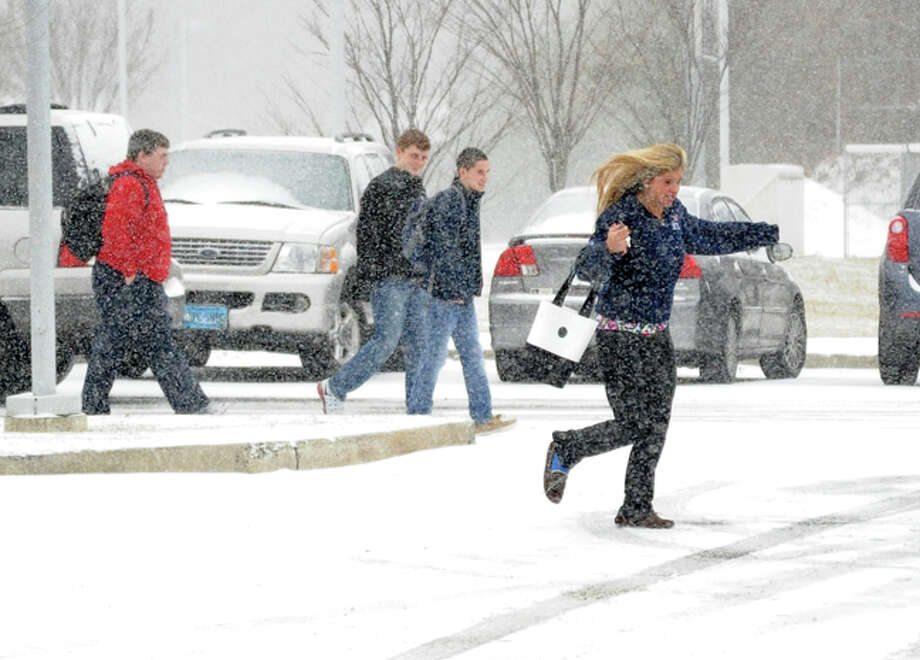 Studenst break for thier cars for the early dismissal Tuesday at Brien MvMahon High School. Hour photo/Matthew Vinci