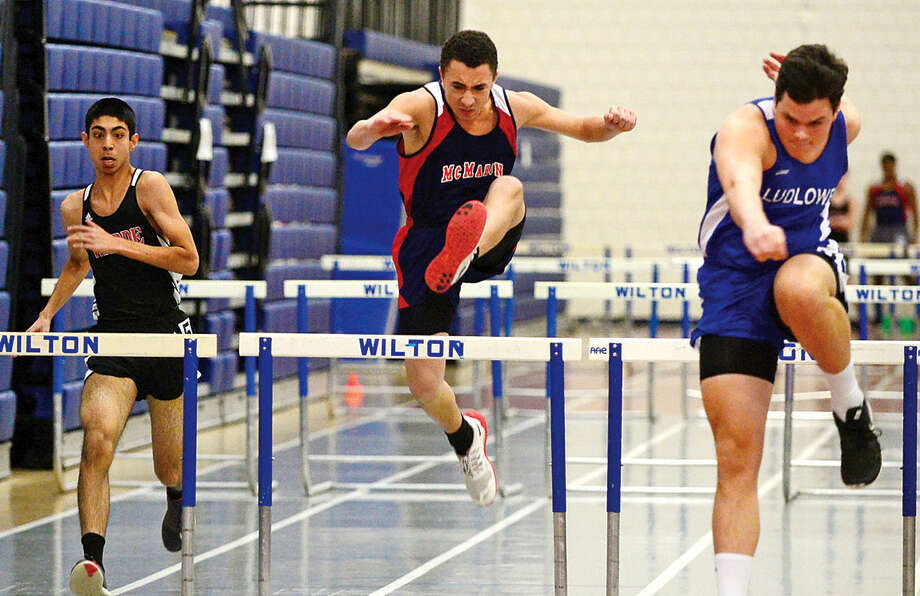 Hour photo / Erik Trautmann Area high School athletes compete in the FCIAC Eastern Division championship track meet at Wilton High School Saturday.