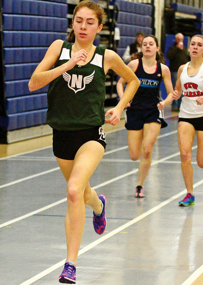 Hour photo / Erik Trautmann Norwalk High School's Amanda Doyle competes in the 600 in the FCIAC Eeastern Division championship track meet at Wilton High School Saturday.