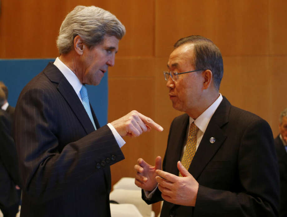U.S. Secretary of State John Kerry, left, talks to U.N. Secretary-General Ban Ki-moon prior to the Syrian peace talks in Montreux, Switzerland, Wednesday, Jan. 22, 2014. The peace talks in the Swiss city of Montreux marked the first time the opposition and the Syrian government will sit down face to face since their dispute began in March 2011. (AP Photo/Arnd Wiegmann, pool)
