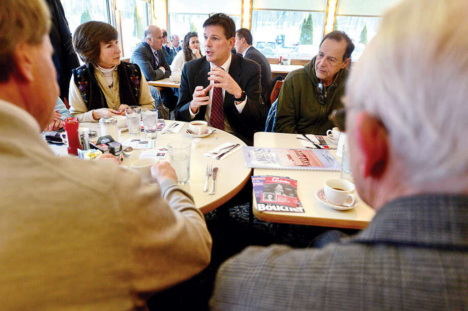 """State Rep. Tom O'Dea, center, chats with constituents as he and state Sen. Toni Boucher and state Rep. Gail Lavielle hold a """"Coffee Hours"""" public discussion at Orem's Diner in Wilton Tuesday morning."""