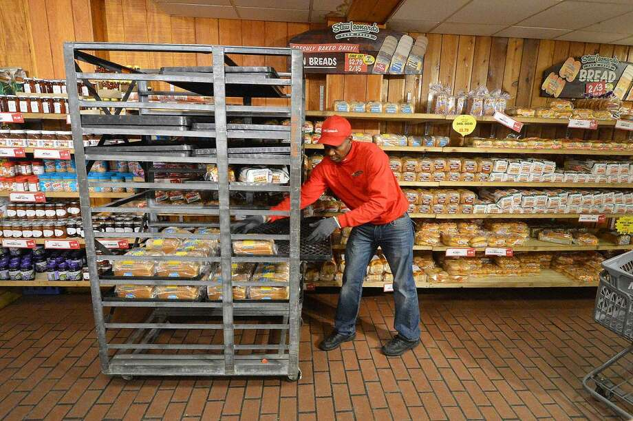 Hour Photo/Alex von Kleydorff More bread hits the shelves at Stew's on Monday afternoon