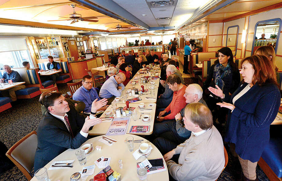"""State Rep. Tom O'Dea, left, chats with constituents including Amy Pines, right, as he and state Sen. Toni Boucher and state Rep. Gail Lavielle hold a """"Coffee Hours"""" public discussion at Orem's Diner in Wilton Tuesday morning."""