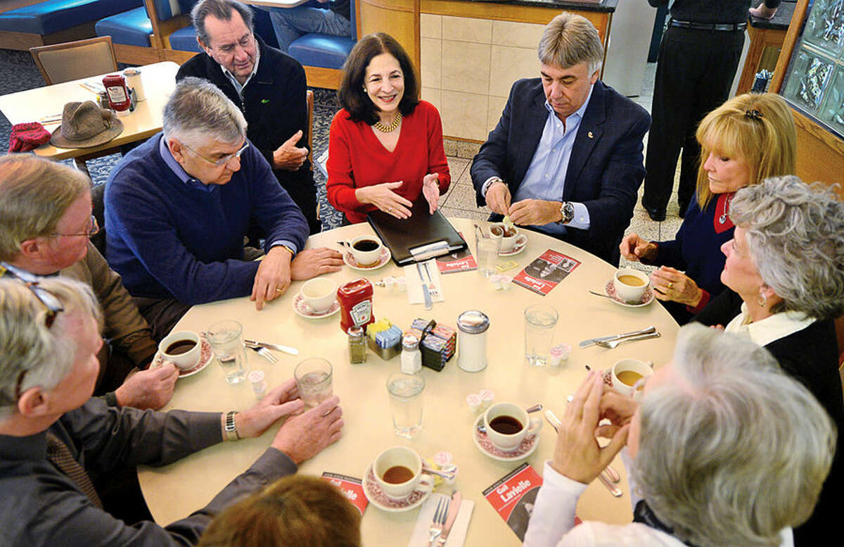 """State Rep. Gail Lavielle, center, chats with constituents as she and state Rep. Tom O'Dea and state Sen. Toni Boucher hold a """"Coffee Hours"""" public discussion at Orem's Diner in Wilton Tuesday morning."""