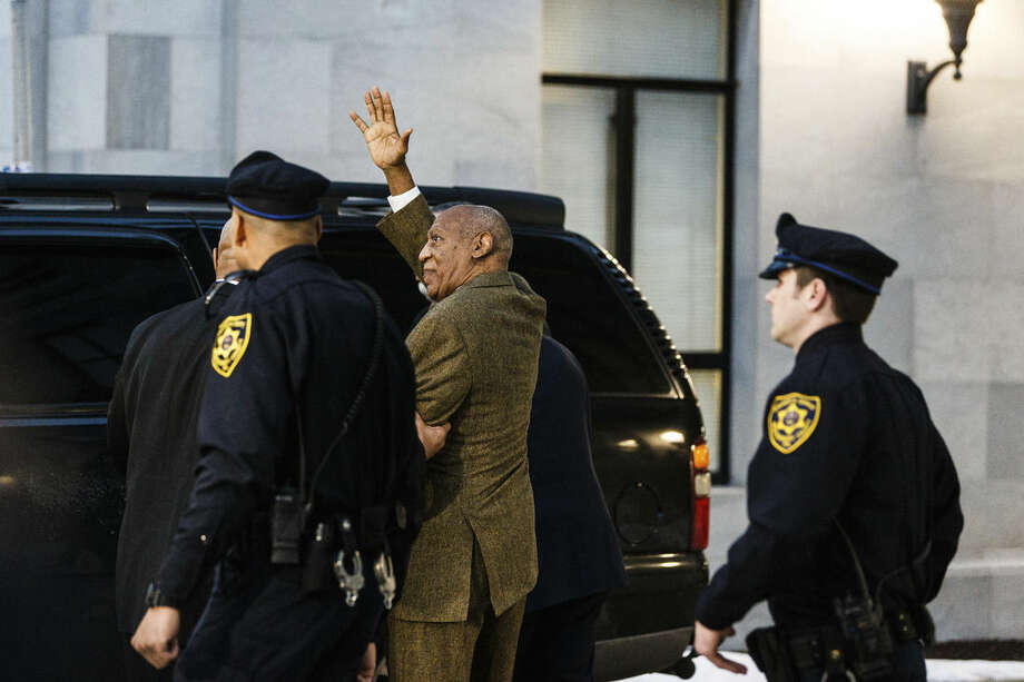 Bill Cosby, left, leaves after a court appearance Tuesday, Feb. 2, 2016, in Norristown, Pa. Cosby was arrested and charged with drugging and sexually assaulting a woman at his home in January 2004. (James Robinson/PennLive.com via AP) MANDATORY CREDIT