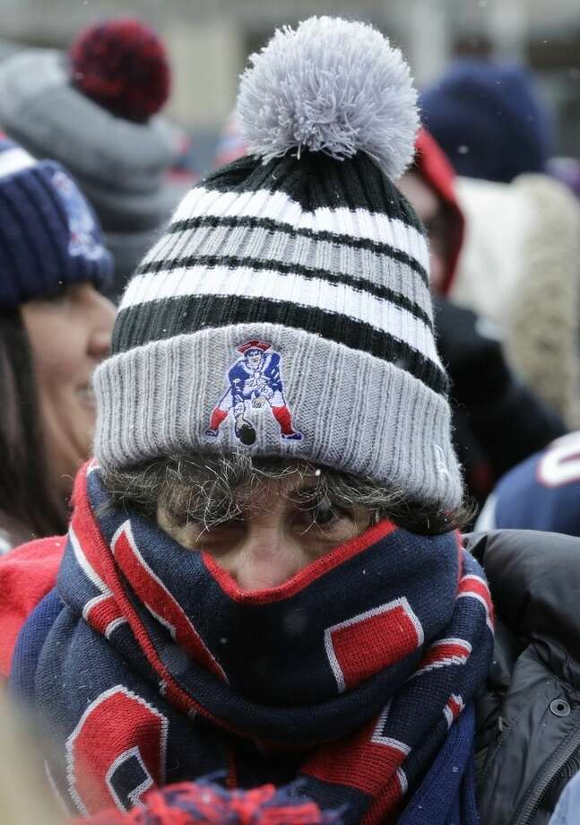 New England Patriots fan Sam Ketchum, of Lowell, Mass., is bundled up as she waits for the team to arrive during an NFL football send-off rally at City Hall in Boston Monday, Jan. 26, 2015. The Patriots play the Seattle Seahawks in Sunday's Super Bowl XLIX in Glendale, Ariz. (AP Photo/Charles Krupa)