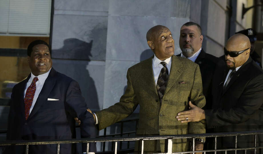 Bill Cosby, center, looks toward cheering fans as he leaves after a court appearance Tuesday, Feb. 2, 2016, in Norristown, Pa. Cosby was arrested and charged with drugging and sexually assaulting a woman at his home in January 2004. (AP Photo/Mel Evans)