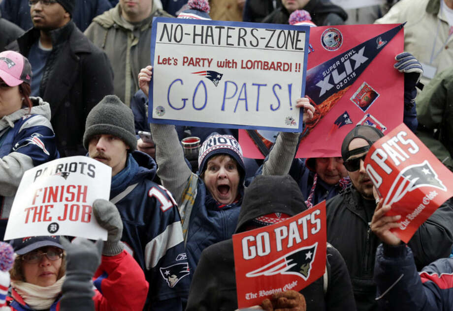 New England Patriots fans cheer before the start of an NFL football send-off rally at City Hall in Boston Monday, Jan. 26, 2015. The Patriots play the Seattle Seahawks in Sunday's Super Bowl XLIX in Glendale, Ariz. (AP Photo/Charles Krupa)