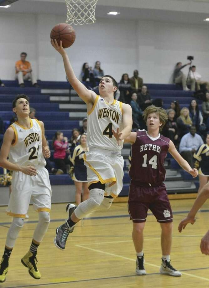 Hour photo/Alex von KleydorffWeston's Andrew Folger (4) puts the ball in the hoop during Tuesday night's SWC encounter against Bethel.