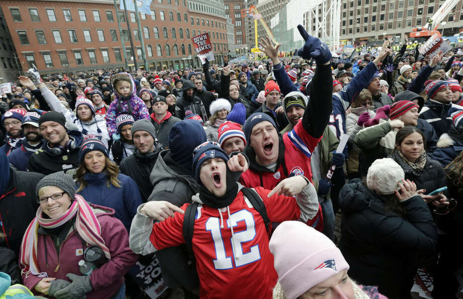 New England Patriots fans cheer during an NFL football send-off rally at City Hall in Boston Monday, Jan. 26, 2015. The Patriots play the Seattle Seahawks in Sunday's Super Bowl XLIX in Glendale, Ariz. (AP Photo/Charles Krupa)