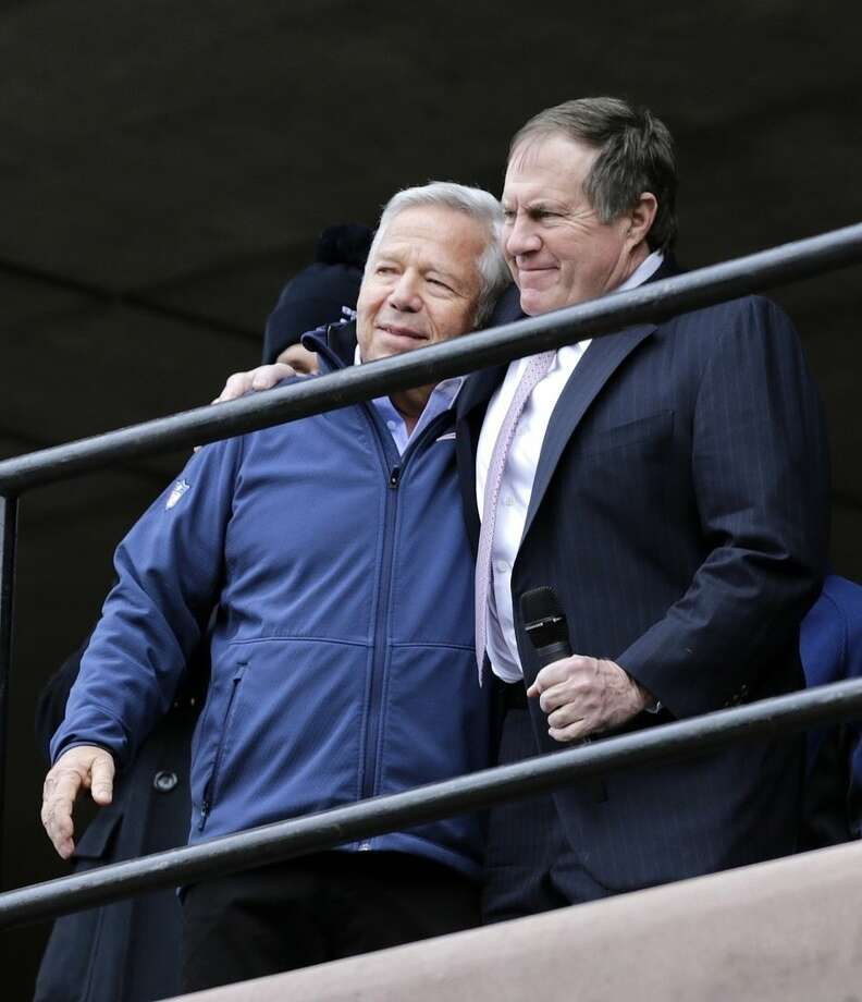 New England Patriots head coach Bill Belichick, right, embraces team owner Robert Kraft during an NFL football send-off rally at City Hall in Boston Monday, Jan. 26, 2015. The Patriots play the Seattle Seahawks in Sunday's Super Bowl XLIX in Glendale, Ariz. (AP Photo/Charles Krupa)