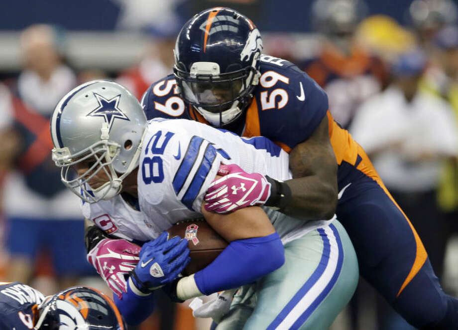 FILE - In this Oct. 6, 2013, file photo, Dallas Cowboys tight end Jason Witten (82) is stopped by Denver Broncos linebacker Danny Trevathan (59) during the first quarter of an NFL football game in Arlington, Texas. His season began in embarrassing fashion with a fumble at the goal line, but Trevathan promised to learn from his mistake and move on. He's done just that, leading the Broncos in tackles and helping the defense withstand the loss of five starters to injuries to surge into the Super Bowl.(AP Photo/Tony Gutierrez, File)